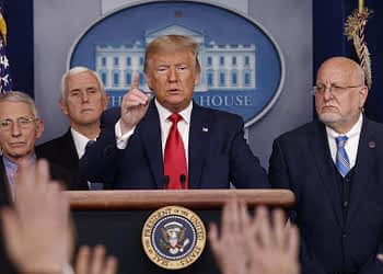 President Donald Trump, center, points as he prepares to answer question after speaking about the coronavirus in the press briefing room at the White House in Washington. (AP Photo/Carolyn Kaster, File)
