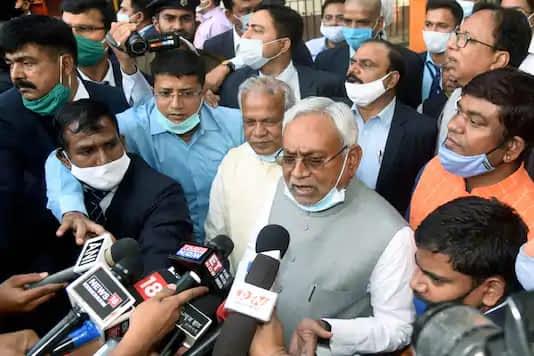 JD(U) president Nitish Kumar addresses the media as HAM(S) chief Jitan Ram Manjhi and other leaders look on, in Patna on Sunday. (PTI)