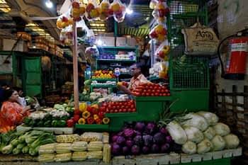 A vendor sells vegetables at a retail market. (Reuters/file photo)