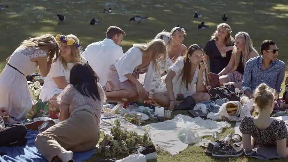 People picnic during the annual Midsummer celebrations in Stockholm, Sweden. Sweden